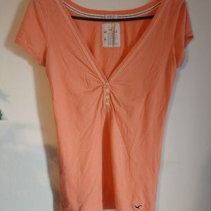 Hollister button t-shirt in peach size M